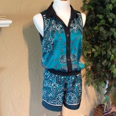 Michael Kors sleeveless romper Super cute and comfortable.  Beautiful colors and pattern.  100% Polyester MICHAEL Michael Kors Dresses