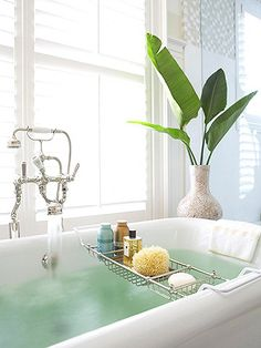 Free up space in your vanity by storing bath essentials right on the tub! More easy bath storage: http://www.bhg.com/bathroom/storage/storage-solutions/easy-bath-storage/?socsrc=bhgpin062313tub=10