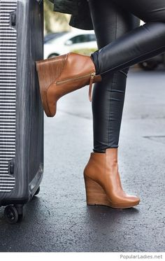 Black leather pants with brown shoes