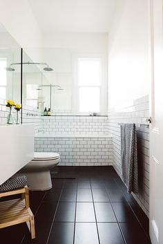 Yes! This is our layout. Dark floor tile, glass by the tub, white subway tile in shower