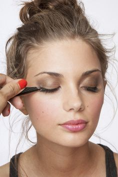 how to put on fake lashes.