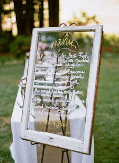 At least one of the 17 old windows in our house can be put to good use! I love this idea for our wedding :)