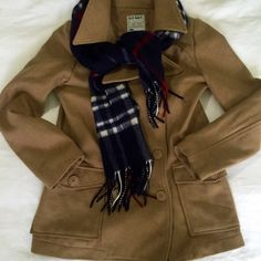"""🎉SALE🙌 Old Navy Camel tan wool peacoat Old Navy Camel tan wool double breasted peacoat. So warm! Hits at the hip with a slimming double button closure and optional back belt loops. Belt has gone missing but the jacket is well tailored and loops are on the back seems so it would be very easy to remove. Very small spots near the hem and cuff that started to come off with just a little cloth and water. / Bust 18"""" shoulder to hem 28"""" Old Navy Jackets & Coats Pea Coats"""
