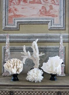 Chic tones of grey & white! Grey marbles obelisks among white coral. Carolyn Roehm