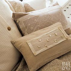 Layer crisp white organza over oatmeal-color linen pillows and embellish with buttons or other elements for a decorative touch.