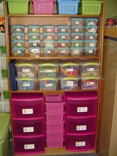 organization using plastic shoe boxes and a book shelf. very uniform and clutter free
