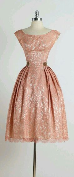 I love the pleats and lace overlay.