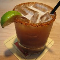 Tamarind Margarita:   4 oz blanco tequila  3 oz tamarind concentrate  1 oz simple syrup  chili powder for rimming  1 cup ice