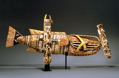"""Malagan figures from New Ireland, Papua New Guinea. Mid 1900s. These figures are described as """"skins"""" that contain the life force of a deceased person during a funerary ritual. While it is not intended to be a picture of the deceased, it is thought of as an image of the life force that produced and animated the once living person."""