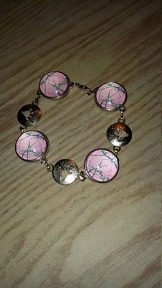 Silver tone buck and pink camo snap bracelet...deer hunting camoflauge jewelry by CamoAndAmmoBoutique on Etsy