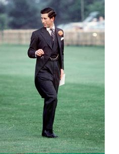 1979  Strutting across the green at ascot in a dovetailed suit, a portrait of classic Savile Row tailoring.