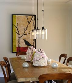 trio of glass pendant lights over the dining room table