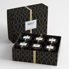Nest votive candle set: individual candles representing top-selling scents, including bamboo, grapefruit, Moroccan amber, moss and mint, orange blossom, and wasabi pear