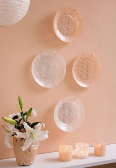 Cover the back of glass plates with lace and modge podge.