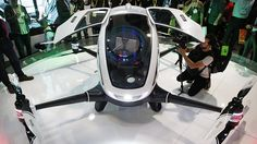 Chinese entrepreneurs bring their one-person craft, which is controlled by tablet and capable of flying 60mph, to the annual technology convention