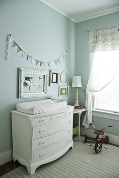 Like the wall art. Empty picture frame put some string behind it clothes pin add pics done