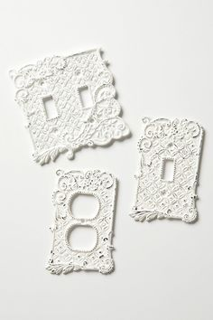 Tin roof switch plates from Anthropologie, of course. A whitewashed iron rendering of pierced tin tiles, covered with creeping vines. $18.00 #decor #details