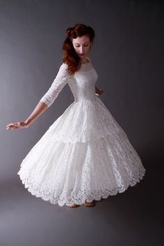 Vintage 1950s Tea Length New Look Wedding Dress of Chantilly Lace. $450.00, via Etsy.