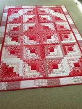 Red and white log cabin quiltI like this log cabin layout. Do this or spiral?Pictures Only but have to See this Quilt Laid OUT Just Beautiful Finally finished my floral log cabin blocksSee the source image I truly appreciate this paint color for this Patchwork Log Cabin, Patchwork Quilt, Log Cabin Quilt Pattern, Log Cabin Quilts, Scrappy Quilts, Mini Quilts, Quilt Top, Quilt Block Patterns 12 Inch, Quilt Patterns Free
