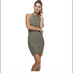 Olive Marled Fitted Ribbed Sweater Dress Killer ribbed sweater racer back tank dress! Content 60% cotton, 40% acrylic.  I have 3 s/m and 2 m/l for sale. Price is firm. This is for brand new with tags retail item. Comment if you would like me to set up a listing. Please let me know what size you need. Tea n Cup Dresses Mini
