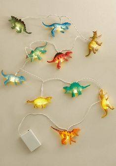 dinosaur nursery It's important to know the difference between a toy an a perfectly reasonable interior item with which an adult should decorate. These dinosaur string lights from Dis Boys Dinosaur Bedroom, Dinosaur Room Decor, Dinosaur Nursery, Kids Bedroom, Bedroom Decor, Dinosaur Kids Room, Dinosaur Decorations, Dinosaur Light, Bedroom Ideas