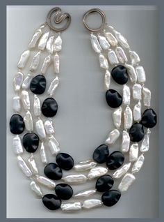 N-3131 Four strands of Freshwater Bar Pearls and black Agate beads on a Ridged Angela clasp, 18K white Gold