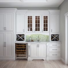 Host happy hour from your very own wine nook featuring cabinets from Woodland Cabinetry. These Artizen style Easton Plus in Maple really hit the mark! Cheers! #woodlandcabinetry #kitchenremodel #winenook