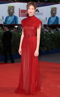 Alba Rohrwacher from 2015 Venice Film Festival: Star Sightings  Red on the red carpet! The star slips into a scarletgown with a tiered collar.