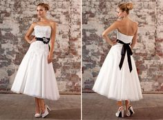 Who said wedding gowns have to be floor length? Show of the wonderful shoes you purchased for your special day.    http://www.essensedesigns.com/dress-D1253