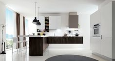"""A solution where the kitchen communicates with the living area  Modern kitchens, wood and laminate. The model Laclip takes its name from its original handle loosely based on a simple paper clip. A new and alternative design ethics where the high aesthetic level does not exclude an affordable budget for everyone. Innovative materials such as melamine thermo-structured oak open pore and polymer laminate """"mat-plus"""""""