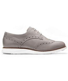 Best For: Menswear Inspired   Made for both men and women and available in a variety of colors, Cole Haan's Original Grand Wingtip Oxfords blend that classic brogue look with sporty sneakers. They're perfect for transitioning seamlessly from the plane to the boardroom: super comfortable, yet fancy enough to impress any client.