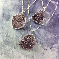 Amethyst cluster necklace pendant. For sale at: http://www.cellsdividing.com/collections/new/products/amethyst-cluster-silver-plated-druzy-druze-necklace-pendant