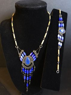 A personal favorite from my Etsy shop https://www.etsy.com/listing/603139577/blue-cat-eye-glass-beaded-set