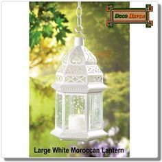 Large White Moroccan Lantern - Light leaps in lacy patterns from the cutwork roof and vine-patterned panels of this alluring candle lantern  lamp. Cast a glamorous aura over an outdoor gathering, or use several together to elegantly illuminate a shadowy garden path!  Only $26.60 plus FREE shipping!