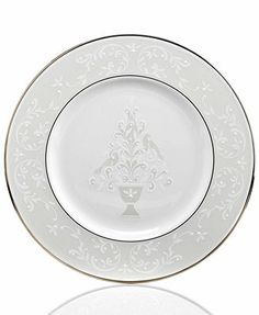 A classic for Christmas. The Opal Innocence holiday accent plate provides a festive twist on the beloved Lenox dinnerware collection with two turtle doves, delicate vines and enamel dots in platinum-b