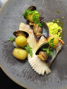 Plaice fish, clams, and parsley mayonnaise by chef Sota Atsumi of Clown Bar in…