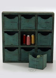 Group items you have multiples of—like stamping, scrapbooking, or sewing supplies—in a cabinet of apothecary drawers.