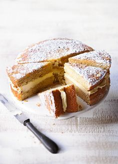 Passion fruit layer cake: An easy-to-make springy sponge cake layered with the tangy, fresh-tasting sweetness of a passion fruit icing. This cake would make a lovely afternoon tea treat.