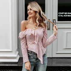 The sexy one-shoulder top is delicate with embroidery throughout the top, novel asymmetrical hem, elegant empire waist, and charming back with hidden zipper back. #ruffle #oneshoulder #top White Ruffle Blouse, Lace Ruffle, Eyelet Lace, Floral Lace, Ruffles, One Shoulder Tops, Cold Shoulder, White Long Sleeve, Wholesale Clothing