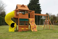 """In addition to a slide, """"treehouse,"""" and rock climbing wall this structure has monkey bars, swings and a picnic area/market?"""