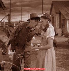 Judy Garland as Dorothy with farmhand, Hunk played by Ray Bolger.