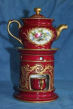 Red teapot with warmer