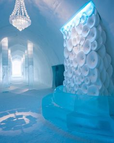 A warm welcome to a cool place. The flower-fall greets you at the entrance, draws you inside, almost like a wishing well. Take a moment to… Ice Hotel, Unique Hotels, Draw Your, Wishing Well, Sweden, Entrance, Ceiling Lights, In This Moment, Warm