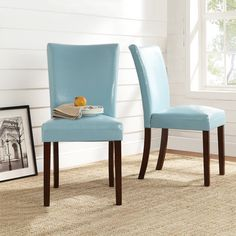 Add a little flair to your dining room or seating area with these sky blue parson chairs. Instantly update your space with these poplar wood and faux leather chairs. The faux leather features makes for easy cleaning and kid-friendly seating.