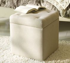 Upholstered File Cube   This compact cube is designed to multitask. Deeply cushioned and detailed with button tufts, it's a comfortable seat or footrest. Lift off the top to reveal hanging storage for letter files.