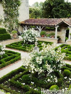 The Cloister Garden in William Christie's 16th-century house in France features the classic rose Katharina Zeimet. ""