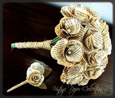 Book Page Bouquet - Book Page Boutonniere -Book Page Flowers -Vintage Paper Flowers -Paper Roses -18 Paper Stem Roses -Eco Wedding. $88.00, via Etsy.