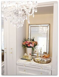 DIY Custom Closet Dressing Room | Crystal chandelier, view of built-in vanity | Vanity marble counter top styling Hermes perfume jewelry tray | Classy Glam Living