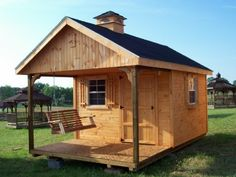 Amish cedar a frame cabin shed with full length porch for Shed with porch and loft