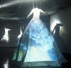 """""""A Marriage of Art and Science"""" DVD Installation: 2 video projectors, 3 body casts, sewn science papers; 2001 - 03"""